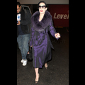Dita Von Teese Tantalizes In Purple Coat