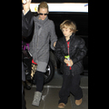 Jenny McCarthy Braves The Airport Crowds With Son Evan