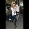 Sarah Michelle Gellar Totes Her Precious Cargo Through LAX