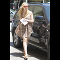 Elle Fanning Has A Penchant For Funky Eyewear