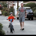 Liev Schreiber Babies His Injured Elbow While Teaching Son Sasha To Ride A Bike