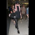 Kesha Arrives At The Airport Looking Like A Rock Star