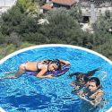 Kourtney Kardashian Passes Time In Quarantine By Chilling In The Pool