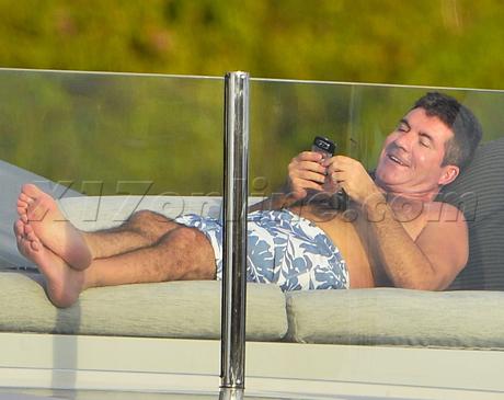 cowell-phone-boat.jpg