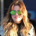 Khloe Kardashian Lands In New York Bright-Eyed And Bushy-Tailed