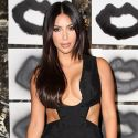 Kim Kardashian Smushes Her Boobs Together In A Scandalous Black Jumpsuit
