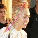 Miley Cyrus Turns Heads With Her Neon Hair Accessories