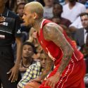 Rihanna Gets Her Glare On When She Watches Chris Brown At Charity Basketball Game
