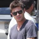 Zac Efron Gives Back Rubs And Flexes His Guns On Set
