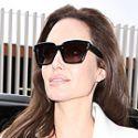 Angelina Jolie Is Elegant In All White As She Arrives At A Screening Of <em>Unbroken</em>