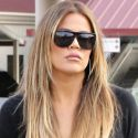 Blonde Bombshell Khloe Kardashian Carries Her Own Bags To The Airport