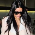 Pregnant Kim Kardashian Dons An Unflattering Unitard At The Airport In London