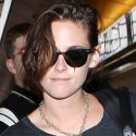 Kristen Stewart Flashes A Rare Smile As She Skips Off To Paris