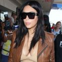 Kim Kardashian Flaunts Her Pregnancy Curves When She Jets Off To New Orleans