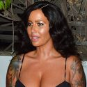 Amber Rose Resembles A Kardashian Sister In A Dark Brunette Wig