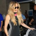Khloe Kardashian Keeps It Sexy At The Airport After Returning From NYFW