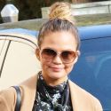 Chrissy Teigen Shows Off Her Lil' Baby Bump In Floral Minidress