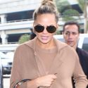 Pregnant Chrissy Teigen Covers Up Her Beige Baby Bump