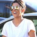 Kourtney Kardashian Is All Smiles After Ex Scott Disick's Bar Brawl In Cannes