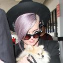 Kelly Osbourne Snuggles Up To Her Pup After Landing At LAX