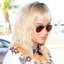 Kesha Flies The Friendly Skies In A Flirty Floral Ensemble