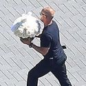 If You Deliver Flowers To Kim Kardashian's House, You Have To Be Packing Heat!