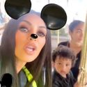 Kim Draws Attention To Herself In A Neon Windbreaker At Disneyland With Her Kids