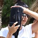 Kourtney Kardashian Makes Unsuccessful Attempt To Hide Behind Her Butt Pack